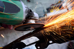 Professional factory grinder cutting through metal Stock Photography