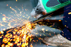 Professional factory worker cutting metal with grinder Royalty Free Stock Photography