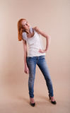 Professional fashionable young red-haired model Stock Photography