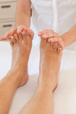 Professional feet massage Stock Image