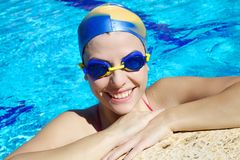 Professional femal swimmer smiling happy Royalty Free Stock Photos