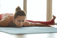 Professional female athlete doing yoga Stock Photos
