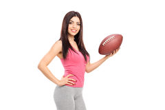 Professional female athlete holding a football Stock Photos