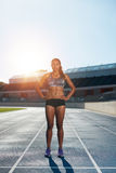 Professional female athlete on race track Royalty Free Stock Photography