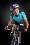 Professional female athlete riding a bike, studio shot. isolated Stock Photography