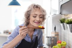 Professional female chef cooking vegetables royalty free stock photography