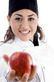 Professional female chef showing fresh apple Royalty Free Stock Images