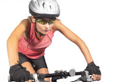 Professional female cycling athlete riding mountain bike and equ Stock Image
