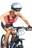 Professional female cycling athlete riding mountain bike wearing Royalty Free Stock Photos