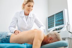 Professional female doctor doing a massage royalty free stock images