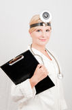 Professional female doctor with folder Royalty Free Stock Photos