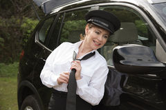 Professional female driver adjusting her tie Stock Images