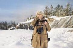 Professional female film photographer in Karelia, Russia Royalty Free Stock Images