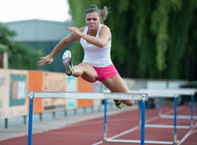 Professional female hurdler Stock Image