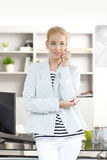 Professional female with mobile phone Royalty Free Stock Images