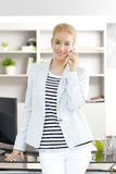 Professional female with mobile phone Royalty Free Stock Photo