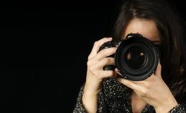 Professional Female Photographer. /Photo-Journalist Composing her Shot Stock Image
