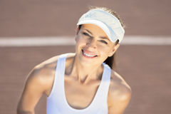 Professional Female Player in Tennis Outfit and Visor Stock Photography