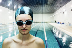 Professional female swimmer. Portrait of female professional competitive swimmer Royalty Free Stock Image