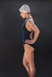 Professional female swimmer on black background Stock Photos