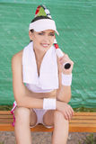 Professional Female Tennis Athlete on Bench Resting Royalty Free Stock Photography