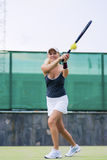 Professional Female Tennis Player in Action On Court. Royalty Free Stock Photos