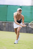Professional Female Tennis Player in Action On Court. Vertical Image Orientation Royalty Free Stock Image