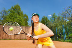 Professional female tennis player in action Royalty Free Stock Image