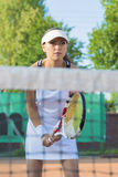 Professional Female Tennis Player Concentrated on Court Stock Image