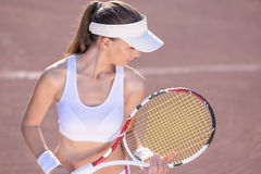 Professional Female Tennis Player on Court Stock Photo