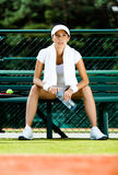 Professional female tennis player rests Stock Photos