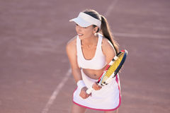 Professional female Tennis Player on Tennis Court Royalty Free Stock Photo
