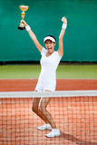 Professional female tennis player won competition. Professional female tennis player won the cup at the sport competition. Victory Stock Photography