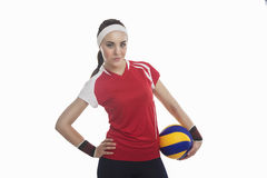 Professional female Volleyball Athlete with Ball Smiling. Professional female Volleyball Athlete with Ball Isolated Against Pure White Background. Horizontal stock photography