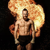 Professional fighter with fire on background Royalty Free Stock Photos