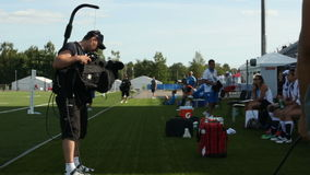 Professional Film Crew Prepares Equipment on Modern Arena. KAZAN, TATARSTAN/RUSSIA - MAY 15 2013: Professional film crew prepares shooting equipment on modern stock video
