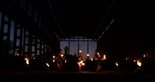 Professional fire show in the old hangar of the aircraft show professional circus artists three women in leather suits stock footage