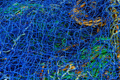 Fishing net in blue and green Royalty Free Stock Images