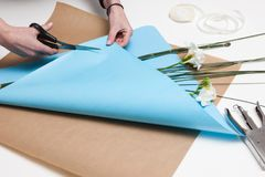 Professional floral arranging close up. Floristics art and gift decoration workshop stock images
