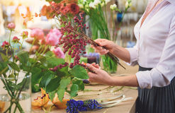 Professional florist making beautiful bouquet royalty free stock images