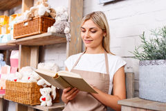 Professional florist working in a flower shop Stock Photography