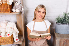 Professional florist working in a flower shop Royalty Free Stock Images