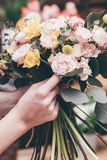 Professional florists making flowers bouquets royalty free stock photography