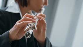 Professional flutist solo player Stock Photo