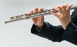 Professional flutist solo player Stock Photos