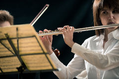 Professional flutist on stage Royalty Free Stock Images