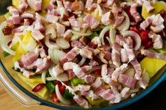 Elegant food photo of potato, pork and bacon baked dish stock images