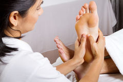 Professional foot massage Royalty Free Stock Photos