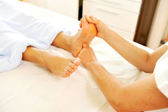 Professional foot reflex zone massage Royalty Free Stock Image