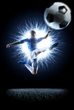 Professional football soccer player in action  on black Stock Photos